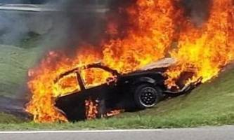 man leans out of window to avoid flames consuming his car during police chase