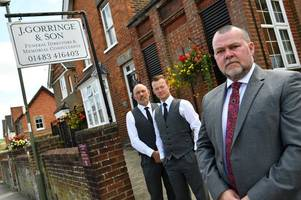 manager of godalming funeral directors 'saddened' and 'disappointed' after flower pots and baskets stolen
