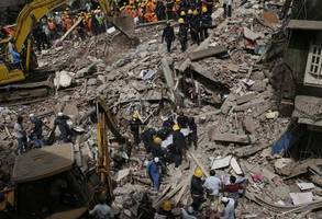 mumbai building collapses leaving two dead and dozens trapped after monsoon rains