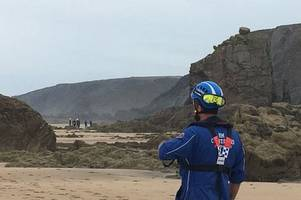 coastguard has 'limited time' to remove trapped body of man crushed by 1.6 tonne rock