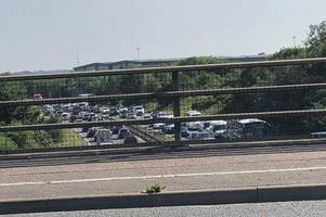 driver left angry after 'morons' hang 'free tommy robinson' sign over a12 bridge