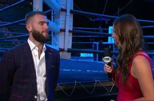 caleb plant talks with heidi androl before his press conference with mike lee