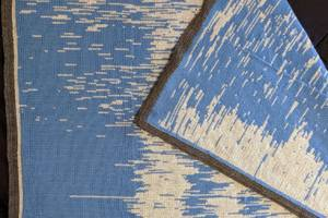 A father knitted his baby's first year of sleep pattern data into a blanket