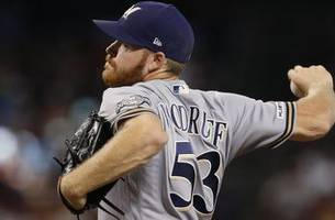 brewers right-hander woodruff heads to il with left oblique injury