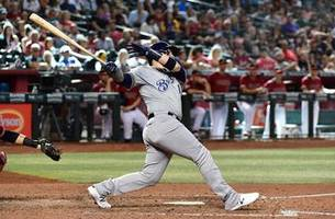 more late-inning runs propel brewers to series-clinching 7-4 victory