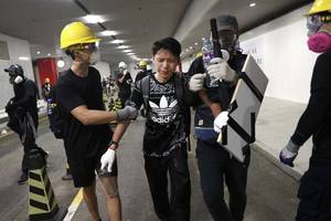 hong kong police accused of inaction after triad attacks on pro-democracy protesters