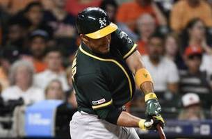 laureano's double in 11th lifts a's over astros 4-3