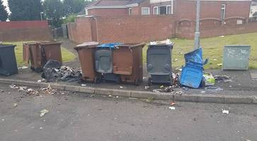 police investigate after bins set on fire in poleglass arson attack