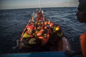 people rescued from migrant boat kept at libyan centre hit by airstrike