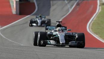 german gp: hamilton on pole as ferrari implodes