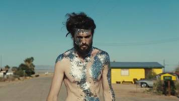 alex ebert's 'hands up' embodies the will to live