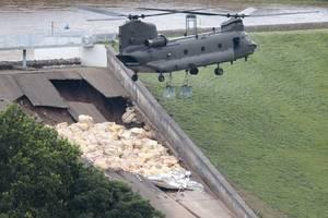 british town evacuated as dam disintegrates