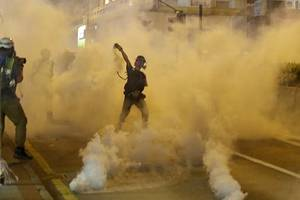 tear gas fired at protesters near liaison office