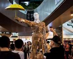 Hong Kong protesters and opponents battle in old communist stronghold