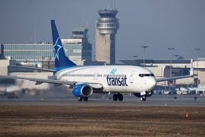 mach tries to stop air transat sale to air canada