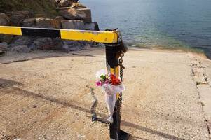 flowers left after holiday tragedy at coast in brixham