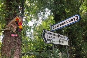 graveley high street crash: flowers left at side of the road where biker tragically died