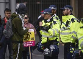 police officer charged with assault during pro-brexit uk 'yellow vest' demonstration