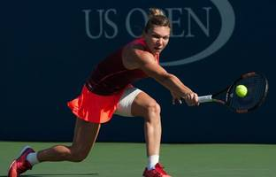 halep hits back against alexandrova, nishikori goes down