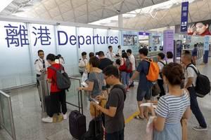 Hong Kong airport reopens amid warnings over pro-democracy protests