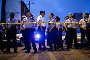 philadelphia mayor calls for gun control after six police officers shot during standoff