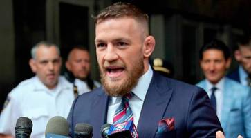 Fight star McGregor is 'caught on camera' punching man in pub