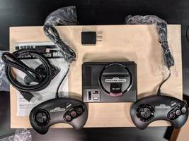a mini version of the classic sega genesis is almost here, but we got it a month early — take a look