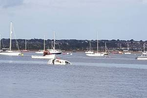 live updates as van sinks into river exe estuary