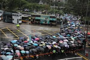 Hong Kong protests: Thousands of schoolteachers march through streets in latest demonstration