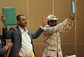 sudan's military signs final power transition deal with opposition