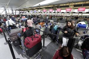 us customs system crashes at airports across the entire country causing huge lines of frustrated passengers and chaos for immigration officials who were unable to process arrivals