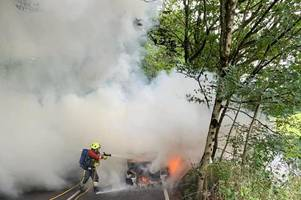 firefighters tackle dramatic car blaze