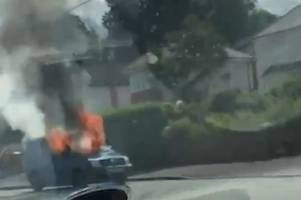Flames can be seen pouring from a van on fire in Carmarthen in this video