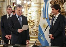 argentina's new economy chief assures imf of fiscal targets