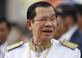 cambodian pm sues opposition leader in french court