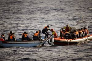 desperate migrants jump off rescue ship, seeking italy