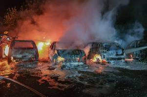 dramatic pictures show fire engulfing '12 cars and caravan' after arson attack