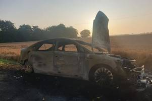 stolen car found burnt-out and dumped on country road