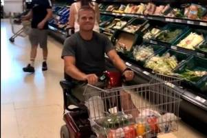 gareth anscombe surprises shoppers with mobility scooter trip to the supermarket