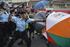 merkel says hong kong's rights should be protected