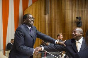 robert mugabe granted national hero status and official mourning