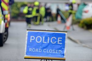 road closed after car crashes into telegraph pole, woman injured - latest updates