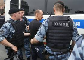 Russia carries out mass raids on Kremlin critic Navalny's supporters