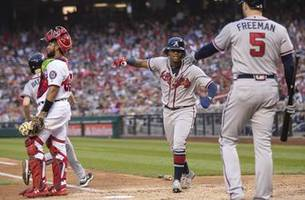 Braves clinch playoff spot behind Acuña Jr.