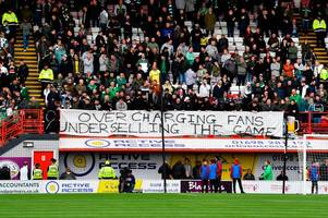 celtic fans hit out at cost of football with banner at hamilton