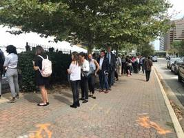 huge crowds of people waited in long lines for tips on how to snag one of 30,000 jobs at amazon career day. here's what it was like on the ground in arlington. (amzn)