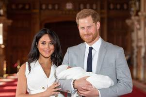 archie's godmother 'revealed' after clue spotted at meghan markle fashion event