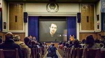 justice dept. sues snowden for writing about intelligence secrets in new book