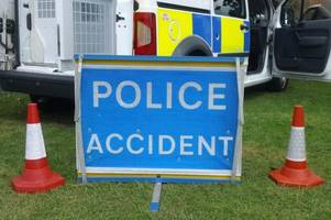three people rushed to hospital after two-car crash closes road