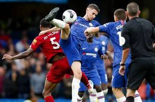 liverpool holds on to beat chelsea as man united loses